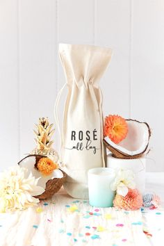Styled Product Photo The Cotton & Canvas Co. Rosé All Day Wine Bag. Spring Modern Pastel Summer Coconut Party Fun. Summer Party Tablescape. Bespoke Styled Product Photography + Photographer in California and Australia by Chelsea Loren.