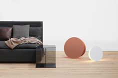 Hand-knitted blanket RETE by Dagmar Heinrich. Side table: VIER by Philipp Mainzer. Floor light: NORTH by Eva Marguerre and Marcel Besau. / www.e15.com #e15 #copper