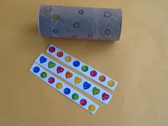 No Mess Busy Bag Ideas for 2 Year Olds  Draw outline of shape of sticker on toilet paper tube for little one to stick on.