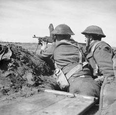 A British Bren gun crew keep watch in a trench at Anzio, 1944.