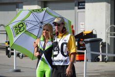Go & Fun Honda Graesini umbrella girl poses with a track staff member @ Indy 2013