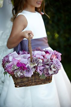 Purple flower girl basket.   Four Seasons Biltmore Santa Barbara Wedding | Miki & Sonja Photography | mikiandsonja.com