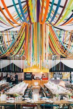 Streamer Ceiling Decor | Warehouse wedding venue in London | City Wedding | Ribbon Decor | Rime Arodaky wedding dress | Bright yellow and orange Colour scheme | Hobbs Bridesmaid dresses | Images by Robbins Photographic | http://www.rockmywedding.co.uk/yvonne-jimmy/