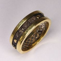 Hand Made and Hammer Forged 18k Yellow gold and Reticulated and oxidized Sterling Silver Man's Wedding Band