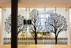 Forward, London by The Interiors group and Jump Studios. I love the black silhouettes on the glass doors.