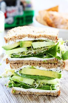 Cucumber and Avocado Sandwich Recipe on twopeasandtheirpod.com This fresh and simple sandwich is made with cucumber, avocado, lettuce, sprouts, and herbed goat cheese.