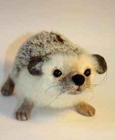 This looks like both an otter and a hedgehog... i think i found Sherlock and John's LOVECHILD!!!!!!!