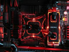 Red and black Computer PC tower liquid cooled setup