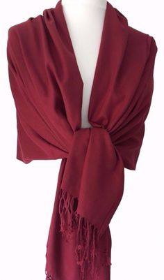 A large burgundy coloured pashmina scarf wrap beautiful and soft tassel trim to the ends Measurements approx 68 inch 170 cm in length and 24 5 inch