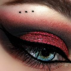 This make up features a sultry dark eyeshadow combo in black and red shades. Learn how to create this look for an evening affair using these products.