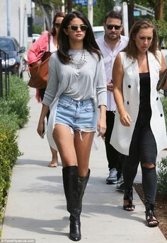 Selena Gomez rocked sexy short shorts and high boots for lunch with her management team at Gracias Madre in West Hollywood on August 19, 2014 http://dailym.ai/1tmQPb2