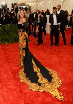 Beyonce arrives in a strapless Givenchy by Riccardo Tisci gown with a paisley-print structured bodice and punky black belt, at the MET Gala. We didn't love this outfit Beyonce, co-chair of the gala, wore. Do you?