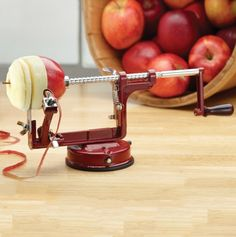 Apple Peeler Machine //  This tool simultaneously removes the apple's skin and core while cutting it into narrow slices that are perfect for pies, desserts, or dehydrating. (Probably great for future chickens to use (with supervision) while hypothetical mom cooks...)