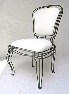 Only $750 each for this Manchez side chair from CASA MIDY.  Just a couple in the living room?  Or maybe eight at the dining table?