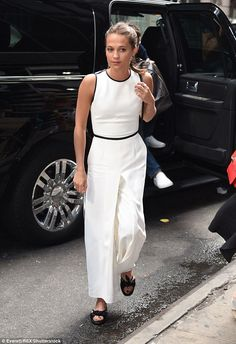 Wow: Alicia looked stunning in a pristine white dress with subtle black trim, which she paired with a cute black studded purse