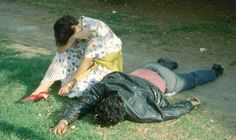 """Enrique Metinides - Chapultepec Park, Mexico City, """"A young woman cries as she sits next to her boyfriend, who had been killed in a robbery that went badly wrong. He looks like he is asleep."""" (caption written by photographer Enrique Metinides. Fine Art Photography, Street Photography, Vintage Photography, Digital Photography, Welcome To Paris, World Press Photo, Post Mortem Pictures, Weegee, Post Mortem Photography"""