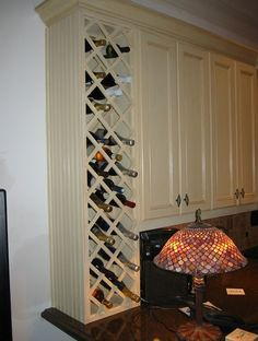 end of cabinet built in wine rack, could leave bottom open for the glasses