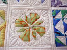 Great photos of some of the Dear Jane blocks quilted by Judi Madsen of Green Fairy Quilts... I want to quilt just like her when I grow up!