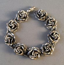 Taxco Sterling Silver Roses Bracelet Mexico Beautiful from Suzy's Timeless Treasures on Ruby Lane