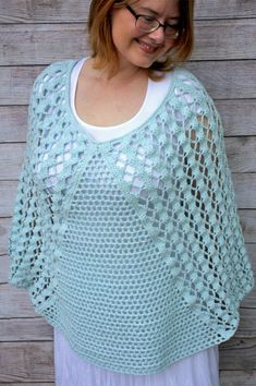 Whimsical Waves Crochet Poncho featuring Lion Brand's Feels Like Butta Yarn #free #crochet #pattern #poncho