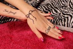 Love this bow tattoo around the wrist!