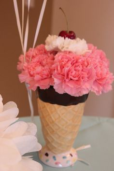 Ice Cream centerpiece at The Villas of Ada Ice Cream Party (Put on by Covenant Developments) - Cone style cups from Pier One, Carnations from Horrock's & a cherry on top!