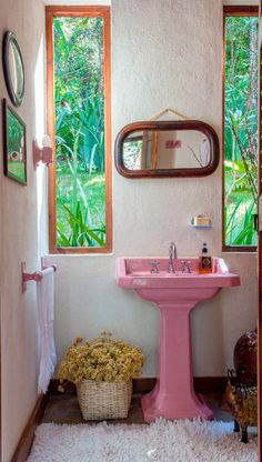 Cool bathroom, like the windows, but the pink sink has got to go.
