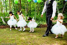 Stephen (the groom) getting the flower girls ready!  #outdoor wedding, #flower girls, #wedding, #balloons, #groom  http://www.teardroppaperie.com
