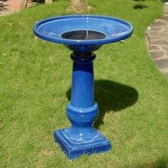 A bird bath in a bold blue adds a large bolt of color. This birdbath not only is pretty, but it's a unique find because it includes a SOLAR-POWERED BURBLE FOUNTAIN. [$279; Athena Solar-powered Birdbath by Grandin Road]