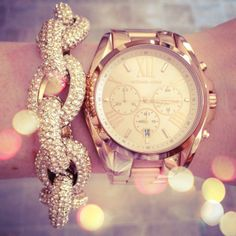Already have the Michael Kors Watch Rose Gold - i want the bracelet  I love big watches, I wear my sweet boyfriends all the time because it is like having a piece of him with me when I am gone:)