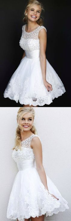Ava Lace Short Wedding Dress: Absolutely GORGEOUS White Wedding Dress! This also would be beautiful as a wedding reception dress or any special occasion. The Ava Lace has a sleeveless top adorned with beautiful pearls. The bottom features a slight flare tulle laced bottom.  TheChicFind.com