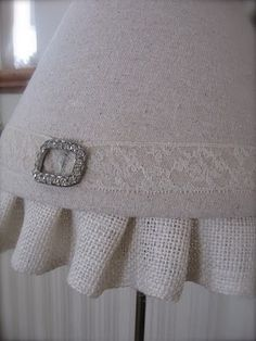 linen shade  with vintage rhinestone shoe clip..