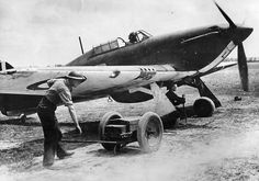 """Crewmen use a trolley accumulator to start up Hurricane Mk I SD-L at Bétheniville in 1940. The aircraft was flown by F/O Arthur D Pickup on a sector patrol with F/O Michael FC Smith in SD-O and F/Sgt Alfred A """"Jammy"""" Payne in SD-P on 10 May to bring No 501 Squadron RAF its first victory. The 27-year-old Scotsman became separated during flight and engaged a Do 17 that he shot down 15m north of Vouziers at 18.30."""