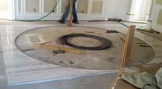 Here, Lucino Escutia has placed the center granite circle for his floor inlay project. He cut this on-site with his AccuGlide 3000PRO Saw and ProCircle attachment.