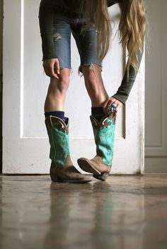 cut offs with cow boy boots :-).  These will work with the brown hat wit a touch of turquoise....enjoy d