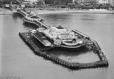 What an insight into how it once was >> Rare aerial photographs: Aerial photos of Britain go online: West Pier, Brighton Brighton England, Brighton And Hove, New Britain, Great Britain, Historic Aerials, Hampden Park, Aerial Images, English Heritage, Vintage Travel Posters