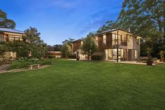 This timber home blends in with the Southern Highlands countryside in New South Wales state, Australia. Owners Charlotte Shields, a craft-supplies business owner, and her husband Brett, an international fire consultant, purchased the approximately 6-acre parcel of land in 2001. Two years later, they built a two-bedroom villa, followed by an 8,417-square-foot, three-bedroom, three-bathroom house in 2011.