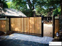 A sliding wood driveway gate.