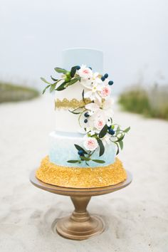 Beach themed wedding cake: http://www.stylemepretty.com/little-black-book-blog/2014/10/29/nautical-bald-head-island-wedding-inspiration/ | Photography: Rachel Red - http://rachelredphotography.com/