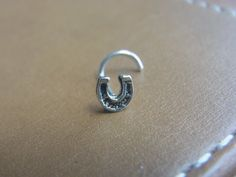 Mini horseshoe sterling silver nose stud / nose screw / nose ring by…