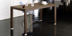 Full-wood dark smoked oak table from alvari set up for dining