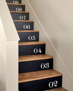 The family in this Texas home stenciled numbers on plywood, which they nailed to their stair risers (painted Black Suede by Behr).   - CountryLiving.com