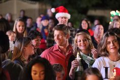 """Burgess Jenkins and Candace Cameron Bure, center, in """"The Heart of Christmas"""" - GMC Photo"""