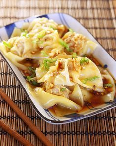 sichan wontons. super easy. super delicious. and folding them is like a craft project of its own. makes about double what you see in the photo. can be made with turkey and no one will know.