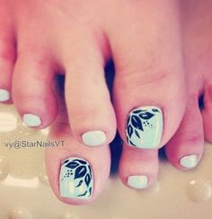 Mint Green Nail Polish with Feather Design on the Corner of the Big Toe.