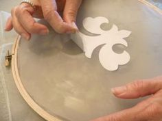 'screen printing' using the mortise mask method. Looks like a fun way of doing it.