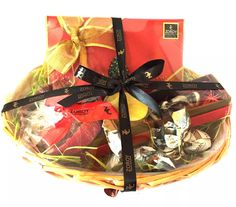 """Christmas """"Feeling Happy"""" Hamper with 12 assorted Chocolate, a yummy plum Cake, a Cookie tin, a box of milk chocolate Santas and candle"""