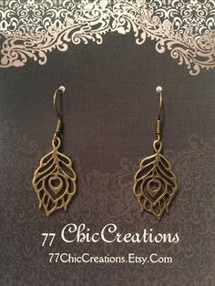 Bronze peacock feather earrings $3