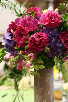 magenta orchids, roses and peonies with purple hydrangea and lisianthus