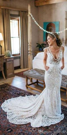 Buy wholesale mermaid boho lace wedding dresses cheap deep v neck with pockets backless court train tulle bridal gowns robe de mariage which is at a discount now. yoyobridal has guaranteed its quality. wedding designers, wedding dress outlet and wedding dress stores are all in the list of superb dresses.
